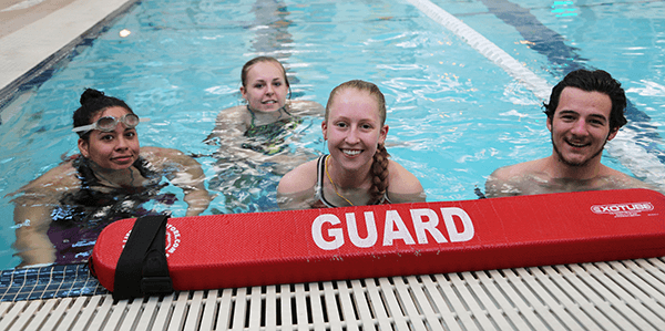 Lifeguards swimming at the YMCA
